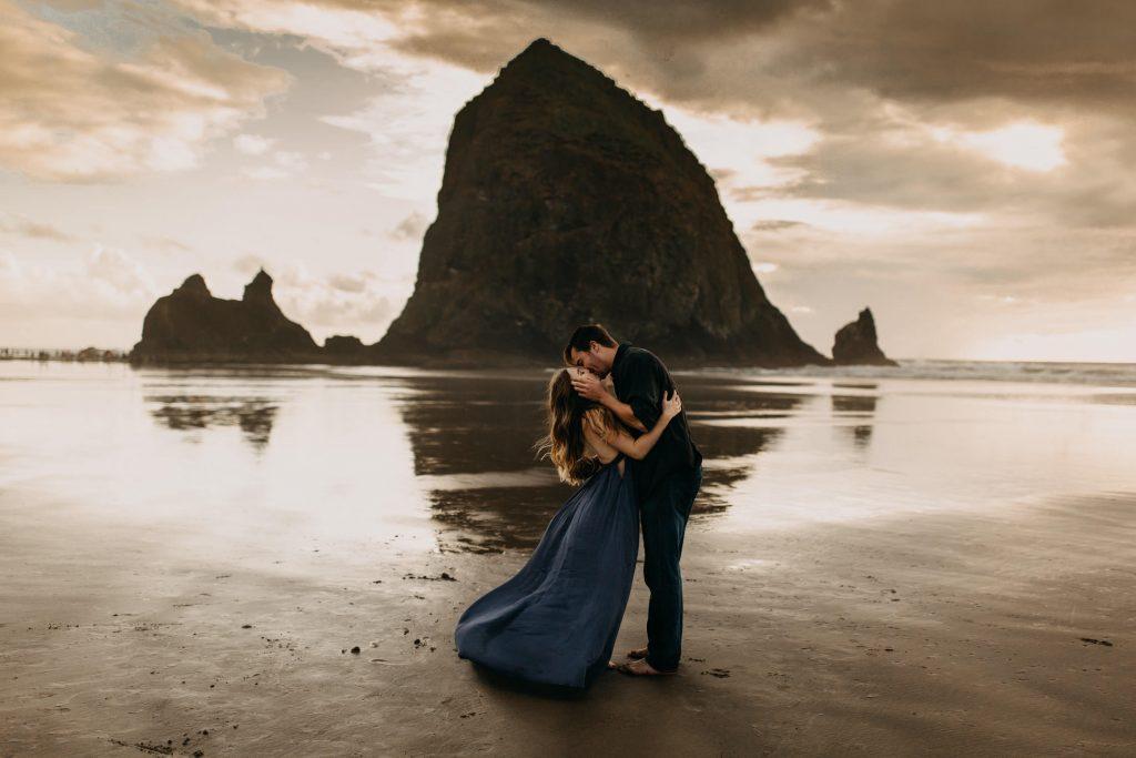 couple on beach kissing dramatically