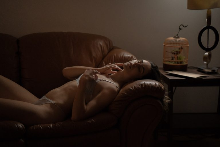 Boudoir image of girl laying on a couch