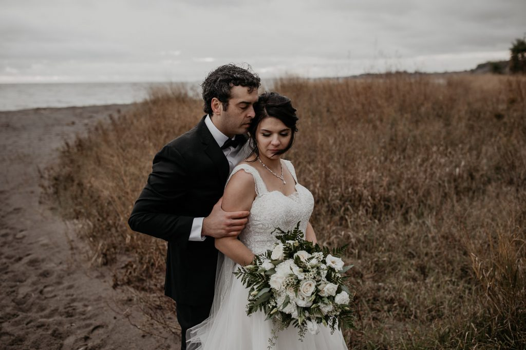 Moody wedding portrait at the beach