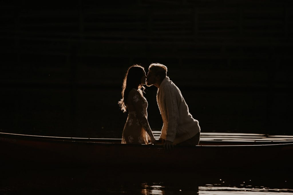 Couple in a canoe with backlight silhouette